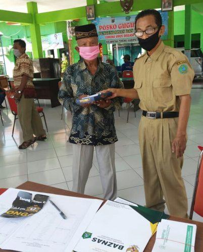 Baznas Kabupaten Sidoarjo Turun ke Desa Bagikan Beras Zakat Fitrah