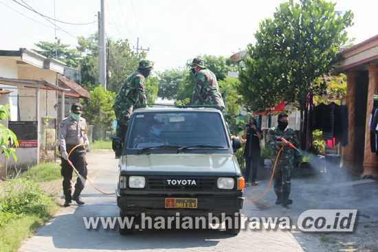 Cegah Covid-19, TNI Bojonegoro – Gugus Tugas Ngrowo Semprot Disinfektan