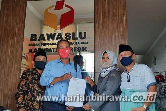 Tebar Pesona, Ketua AKD Kabupaten Gresik Dilaporkan ke Bawaslu
