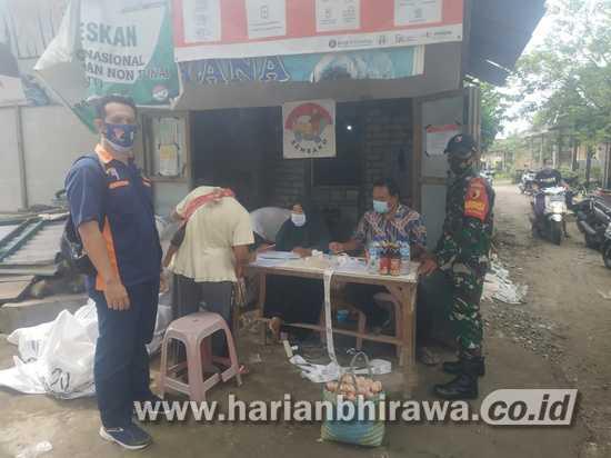 Babinsa Koramil 0814/09 Kudu Jombang Dampingi Penyaluran BPNT